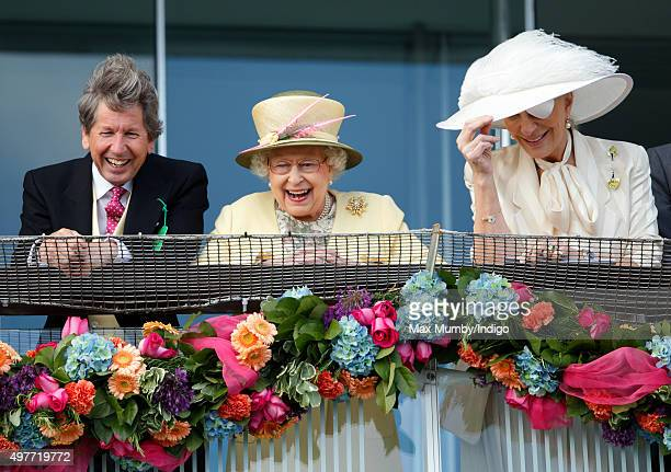 Queen Elizabeth II her racing manager John Warren and Princess Michael of Kent watch the racing from the balcony of the Royal Box as they attend...