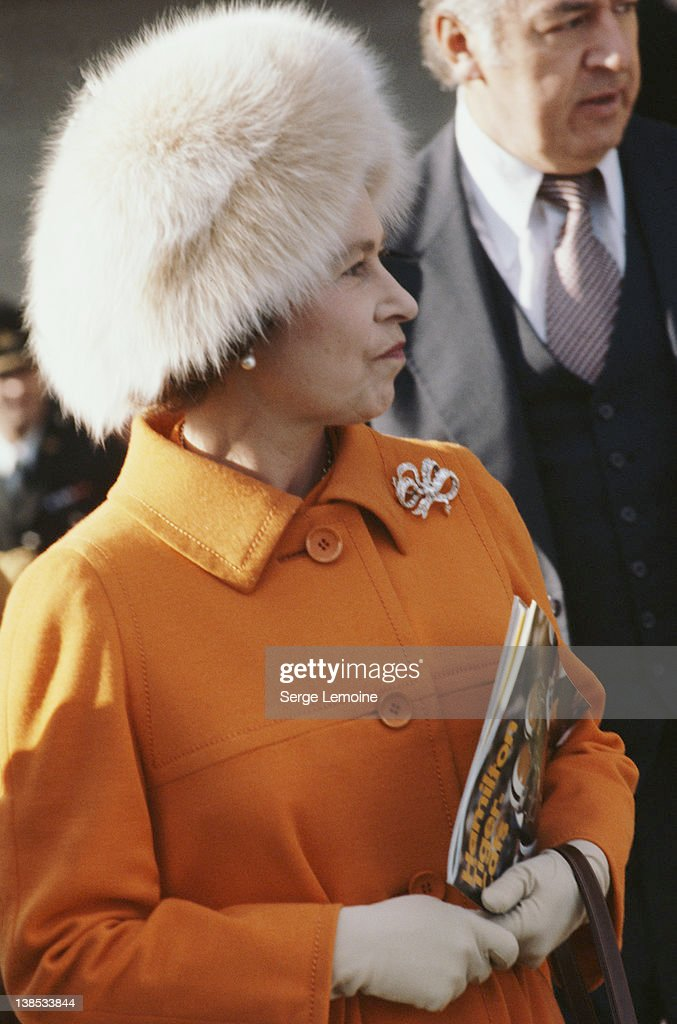 Queen <a gi-track='captionPersonalityLinkClicked' href=/galleries/search?phrase=Elizabeth+II&family=editorial&specificpeople=67226 ng-click='$event.stopPropagation()'>Elizabeth II</a> holding a Hamilton Tiger-Cats magazine, probably during her tour of Canada, circa 1983.