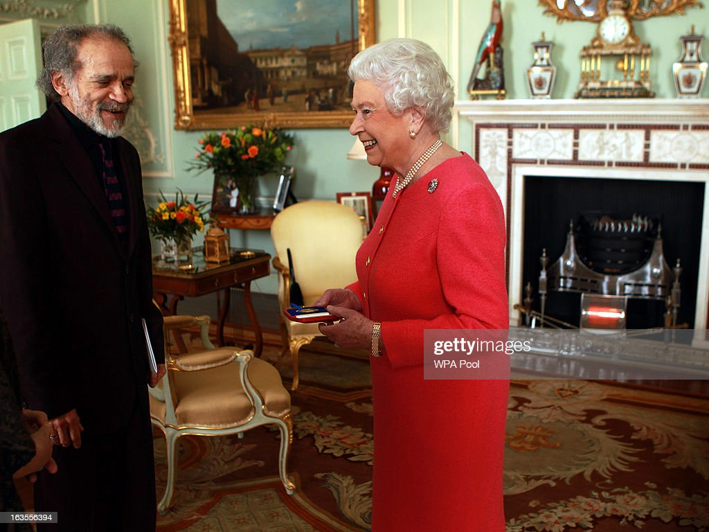Queen <a gi-track='captionPersonalityLinkClicked' href=/galleries/search?phrase=Elizabeth+II&family=editorial&specificpeople=67226 ng-click='$event.stopPropagation()'>Elizabeth II</a> holds a audience with the Queen's Gold Medal for Poetry winner Mr John Agard, at Buckingham Palace, on March 12, 2013 in London, England.