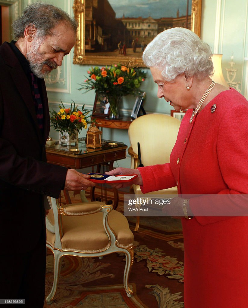Queen Elizabeth II holds a audience with the Queen's Gold Medal for Poetry winner Mr John Agard, at Buckingham Palace, on March 12, 2013 in London, England.