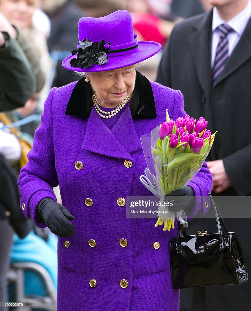 Queen Elizabeth II holds a bunch of flowers given to her by a member of the public during a walkabout after attending Sunday service at the church of St Peter and St Paul in West Newton on February 03, 2013 near King's Lynn, England.