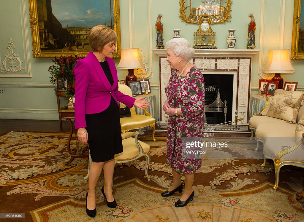 Queen Elizabeth II (R) holds an audience with the First Minister of Scotland Nicola Sturgeon at Buckingham Palace on December 10, 2014 in London, England.