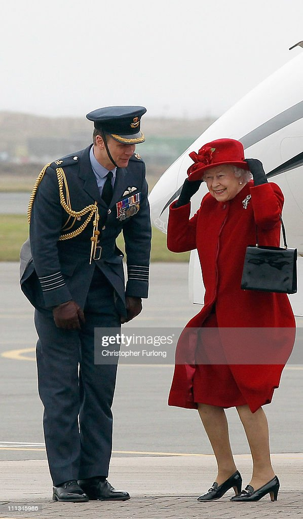Queen <a gi-track='captionPersonalityLinkClicked' href=/galleries/search?phrase=Elizabeth+II&family=editorial&specificpeople=67226 ng-click='$event.stopPropagation()'>Elizabeth II</a> holds on to her hat in high winds as she is greeted by Group Capt Bruce Headley during a visit to RAF Valley where Prince William is stationed as a search and rescue helicopter pilot on April 1, 2011 in Holyhead, United Kingdom. The Queen toured the airbase meeting staff and families, watched a fly past and was given a guided tour of a Sea King search and rescue helicopter by Prince William.