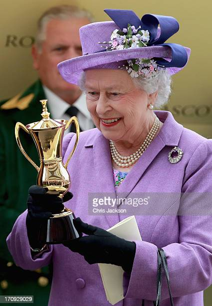 Queen Elizabeth II holds the Gold Cup after Ryan Moore riding Estimate won The Gold Cup during Ladies' Day on day three of Royal Ascot at Ascot...