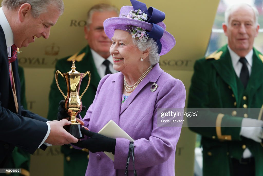 Queen Elizabeth II holds the Gold Cup and Prince Andrew, Duke of York after Ryan Moore riding Estimate won The Gold Cup during Ladies' Day on day three of Royal Ascot at Ascot Racecourse on June 20, 2013 in Ascot, England.