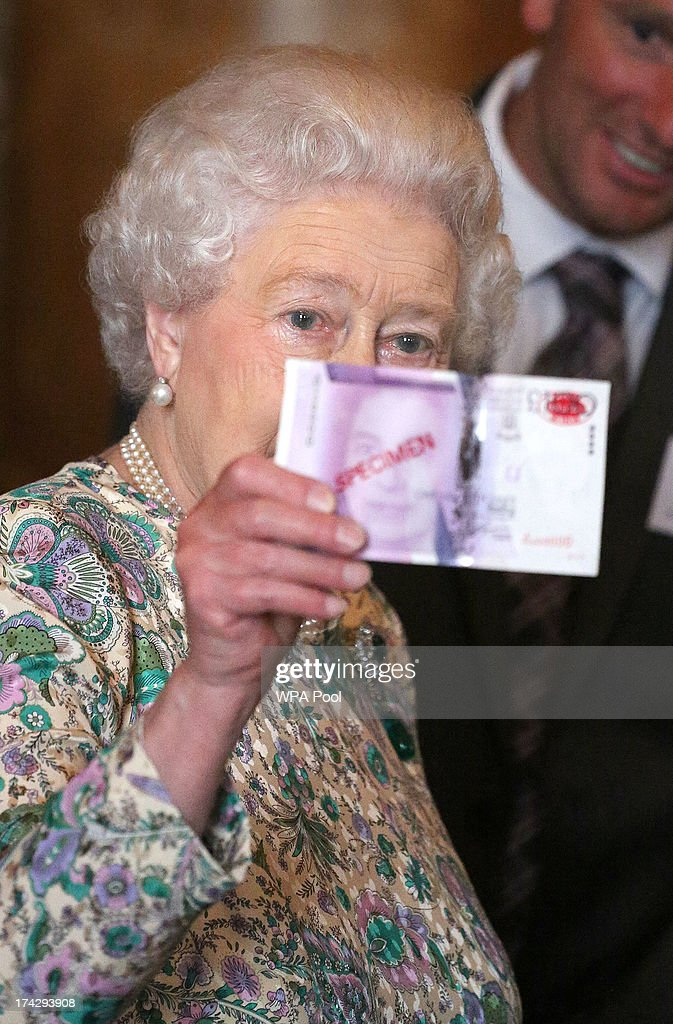 Queen <a gi-track='captionPersonalityLinkClicked' href=/galleries/search?phrase=Elizabeth+II&family=editorial&specificpeople=67226 ng-click='$event.stopPropagation()'>Elizabeth II</a> holds up a mock 100 pound note demonstrating a new sercurity strip at a reception for the Winners of the Queens Award for Enterprise 2013 at Buckingham Palace in London. Tuesday July 23, 2013.