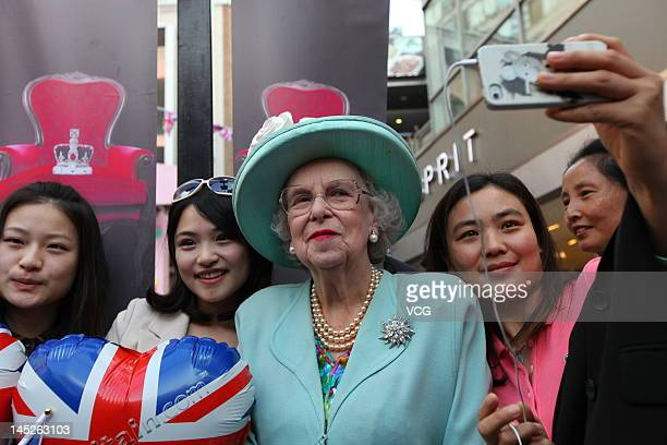 A Queen Elizabeth II impersonator attends a Queen Elizabeth II's Diamond Jubilee Celebration held by British Airways and British Tourist Authority at...