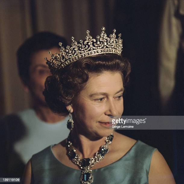 Queen Elizabeth II in a crown and jewelled necklace 1975