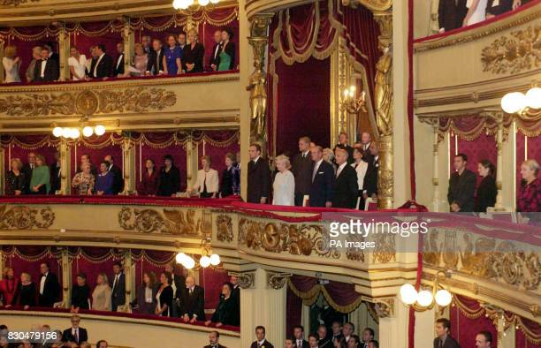 Queen Elizabeth II in a pale blue dress and Prince Philip to her left in the box at La Scala Opera House Milan to see a performance of In The South...