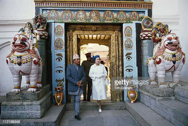 Queen Elizabeth II in Kathmandu during an official tour of Nepal February 1986 The ornate doorway through which the Queen is walking is flanked by...