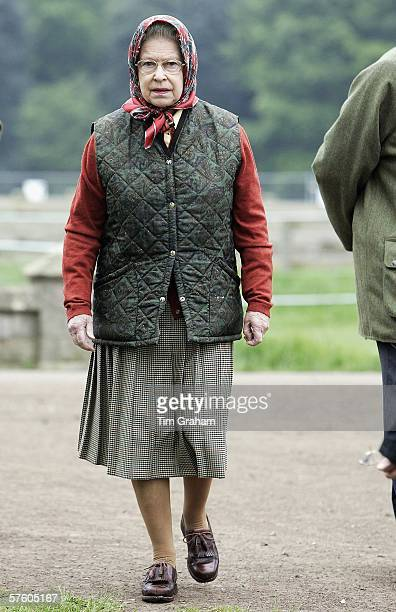 Queen Elizabeth II in quilted jacket and silk headscarf at the Royal Windsor Horse Show Windsor Great Park in the grounds of Windsor Castle on May 13...