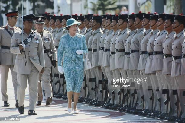 Queen Elizabeth II inspecting a Gurkha guard of honour on her arrival in Hong Kong 21 October 1986