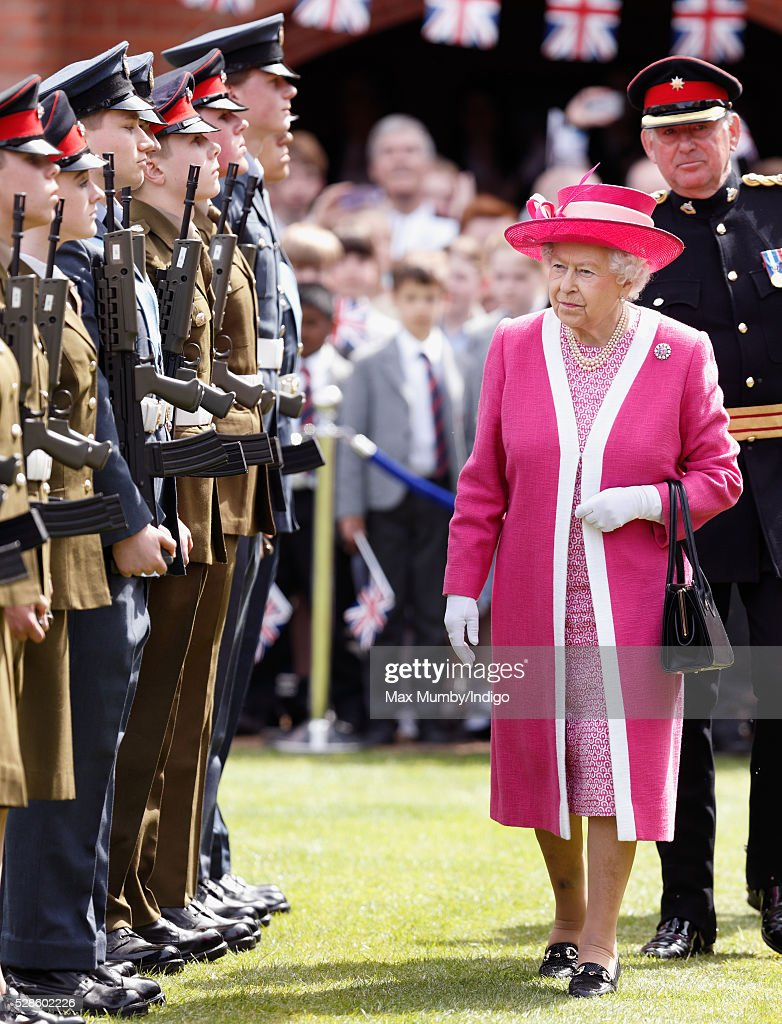 Queen <a gi-track='captionPersonalityLinkClicked' href=/galleries/search?phrase=Elizabeth+II&family=editorial&specificpeople=67226 ng-click='$event.stopPropagation()'>Elizabeth II</a> inspects a Combined Cadet Force Guard of Honour as she visits Berkhamsted School on the occasion of the 475th Anniversary of its foundation on May 6, 2016 in Berkhamsted, England.
