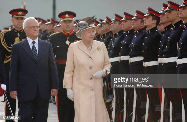 Queen Elizabeth II inspects a Guard of Honour formed by the Armed Forces of Malta accompanied by Maltese President Fenech Adami in St Georges Square...