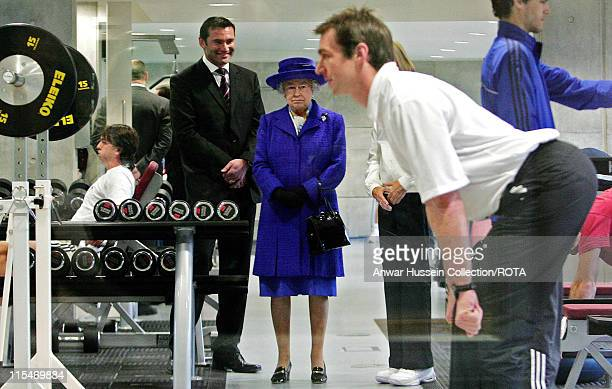 Queen Elizabeth II inspects a gym during her visit to the new National Tennis Centre Roehampton in London on March 29 2007