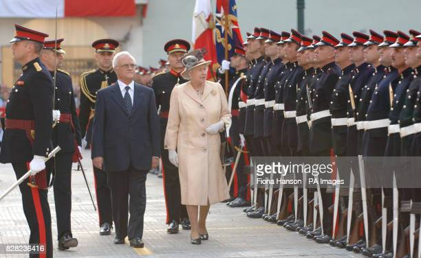 Queen Elizabeth II inspects Guard of Honour formed by the Armed Forces of Malta accompanied by Maltese President Fenech Adami in St Georges Square...