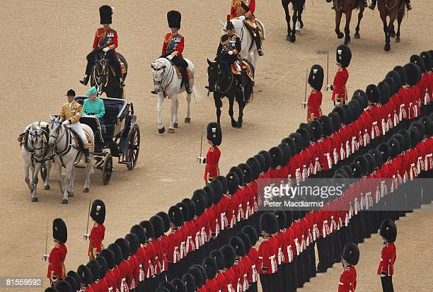 Queen Elizabeth II inspects the ceremonial guard during the Trooping the Colour ceremony on June 14 2008 in London The ceremony is Queen Elizabeth...