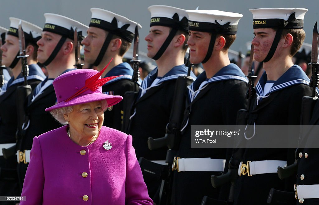 Queen Elizabeth II inspects the Guard of Honour as she arrives for a visit of the Royal Navy's HMS Ocean at Her Majesty's Naval Base Devonport on March 20, 2015 in Plymouth, England.