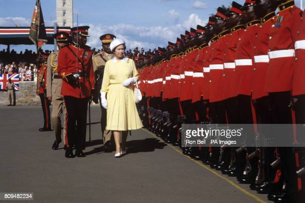 Queen Elizabeth II inspects the Guard of Honour at Jomo Kenyatta International Airport