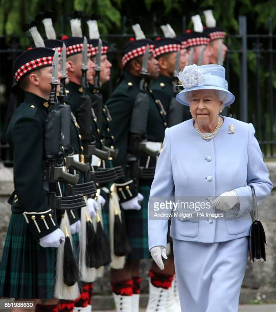 Queen Elizabeth II inspects the Royal Scots Borderers at the gates to Balmoral as she takes up summer residence there