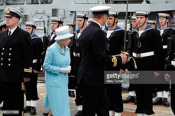 Queen Elizabeth II inspects the ship's company of HMS Lancaster as she visits Portsmouth Naval Base for a visit to the the ship on May 20 2014 in...