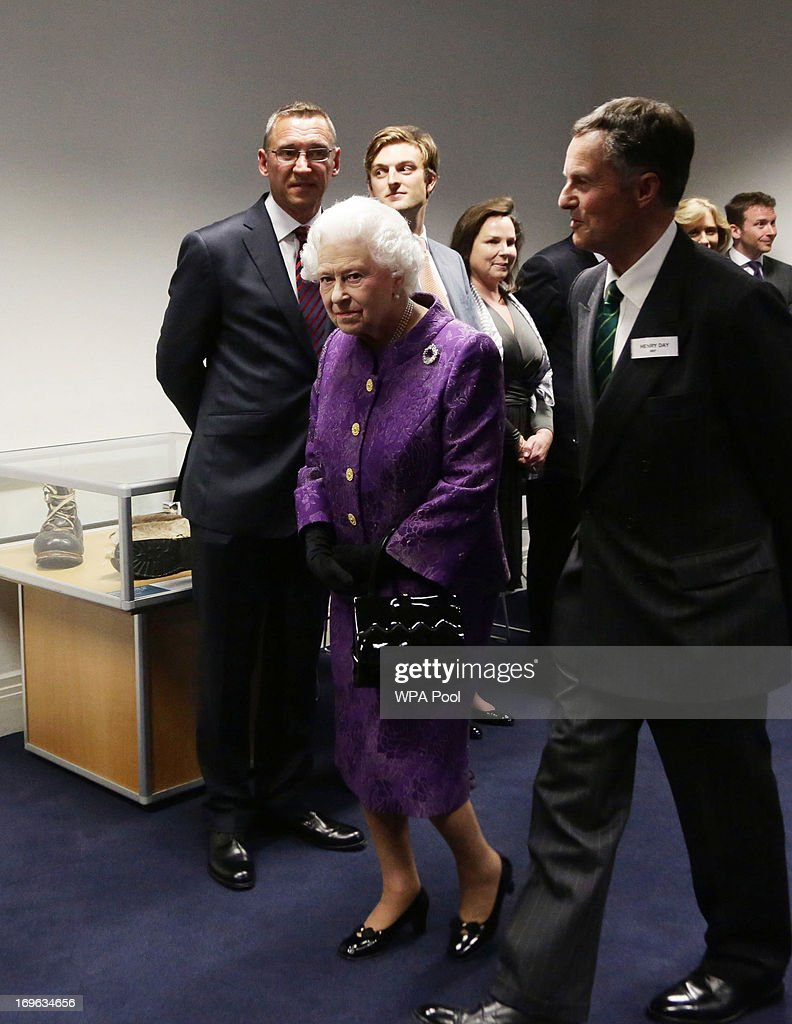Queen <a gi-track='captionPersonalityLinkClicked' href=/galleries/search?phrase=Elizabeth+II&family=editorial&specificpeople=67226 ng-click='$event.stopPropagation()'>Elizabeth II</a> is accompanied by Henry Day, Chairman of the Mount Everest Foundation, at a reception to celebrate the 60th Anniversary of the ascent of Everest, at the Royal Geographical Society in Kensington, on May 29, 2013 in west London, England.