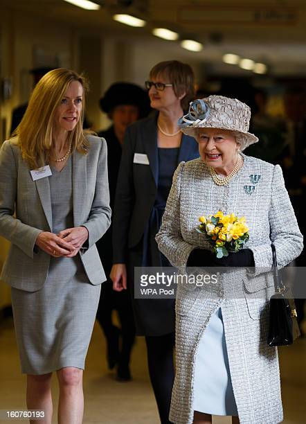 Queen Elizabeth II is accompanied by hospital Chief Executive Patricia Wright as she opens the new MRI unit at The Queen Elizabeth Hospital on...