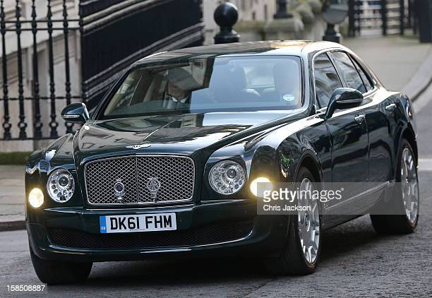 Queen Elizabeth II is driven to Number 10 Downing Street to attend the Government's weekly Cabinet meeting on December 18 2012 in London England