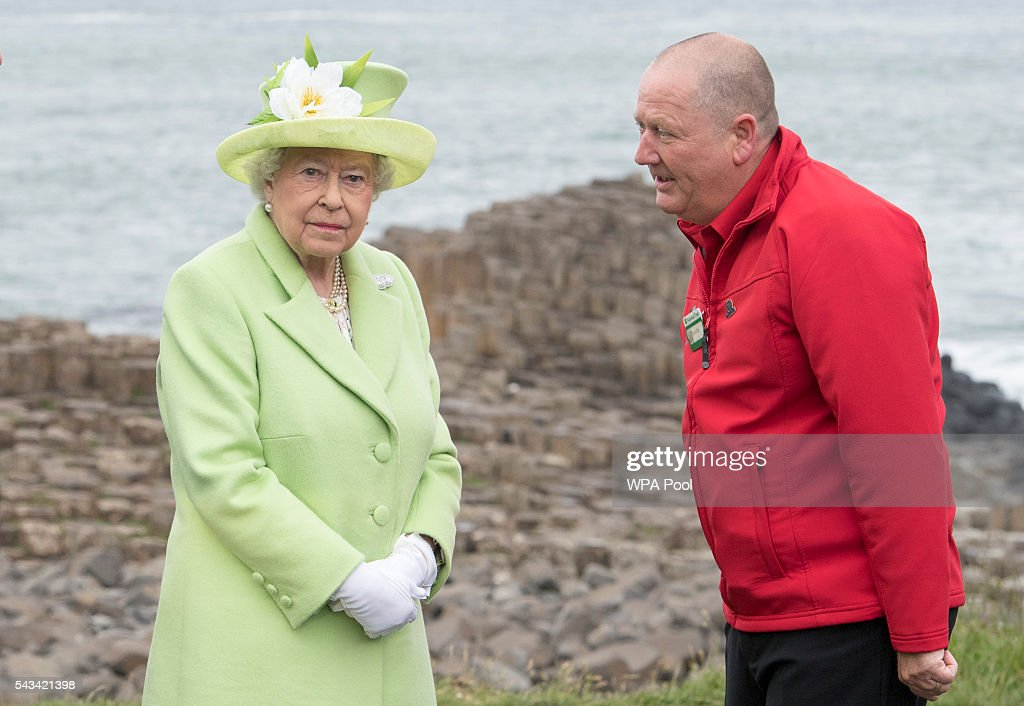 Queen <a gi-track='captionPersonalityLinkClicked' href=/galleries/search?phrase=Elizabeth+II&family=editorial&specificpeople=67226 ng-click='$event.stopPropagation()'>Elizabeth II</a> is escorted by guide Neville Mconachie during a visit to the Giants Causeway on June 28, 2016 in County Antrim, Northern Ireland, United Kingdom.