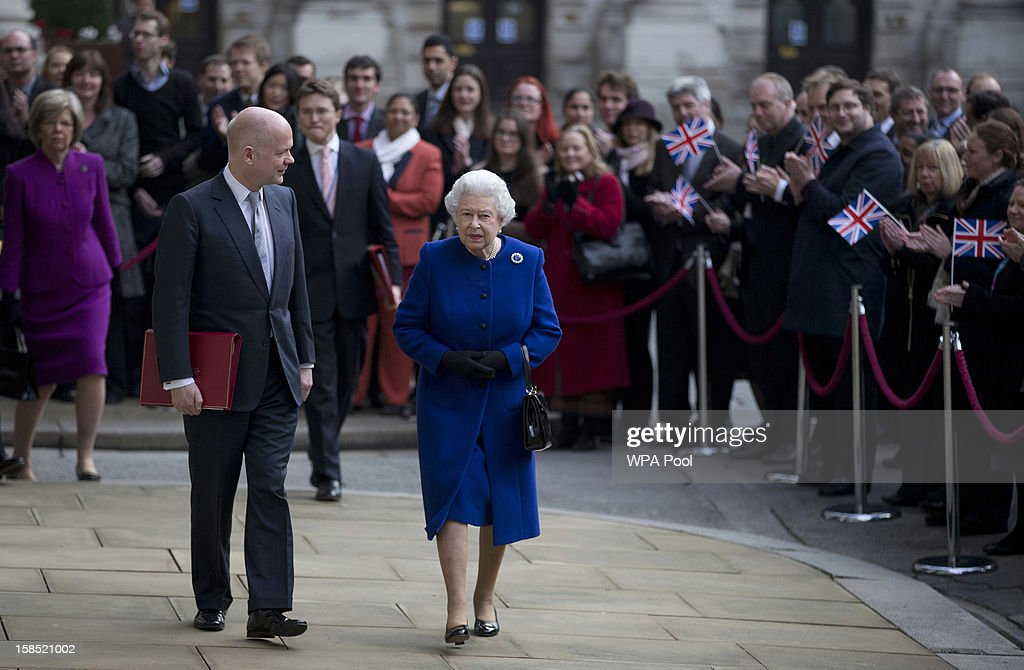 Queen <a gi-track='captionPersonalityLinkClicked' href=/galleries/search?phrase=Elizabeth+II&family=editorial&specificpeople=67226 ng-click='$event.stopPropagation()'>Elizabeth II</a> is escorted by the British Foreign Secretary <a gi-track='captionPersonalityLinkClicked' href=/galleries/search?phrase=William+Hague&family=editorial&specificpeople=206295 ng-click='$event.stopPropagation()'>William Hague</a> as she arrives for a tour of The Foreign and Commonwealth Office during an official visit which is part of her Jubilee celebrations on December 18, 2012 in London, England.