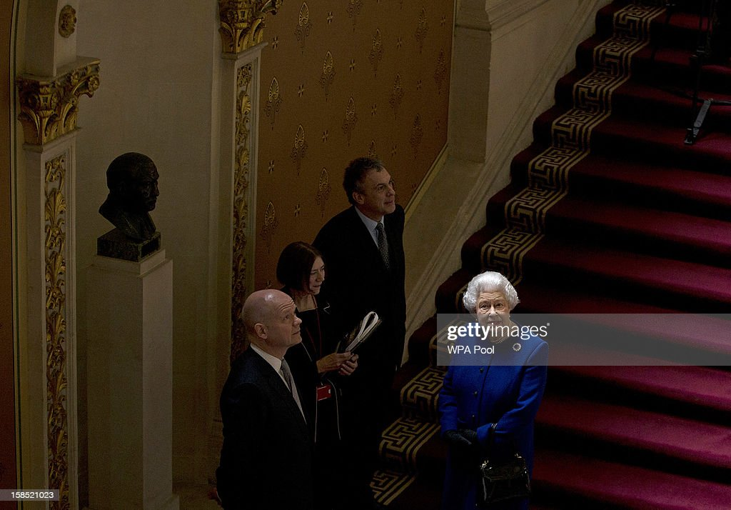 Queen <a gi-track='captionPersonalityLinkClicked' href=/galleries/search?phrase=Elizabeth+II&family=editorial&specificpeople=67226 ng-click='$event.stopPropagation()'>Elizabeth II</a> is escorted by the British Foreign Secretary <a gi-track='captionPersonalityLinkClicked' href=/galleries/search?phrase=William+Hague&family=editorial&specificpeople=206295 ng-click='$event.stopPropagation()'>William Hague</a> as she tours The Foreign and Commonwealth Office during an official visit which is part of her Jubilee celebrations on December 18, 2012 in London, England.