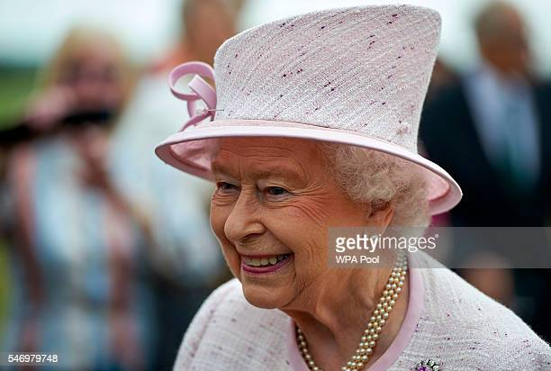 Queen Elizabeth II is given a tour as she opens the new East Anglian Air Ambulance Base at Cambridge Airport on July 13 2016 in Cambridge England