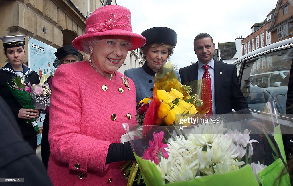 Queen Elizabeth II is given flowers as she leaves following her tour of the recently refurbished Bristol Old Vic Theatre on November 22, 2012 in Bristol, England.