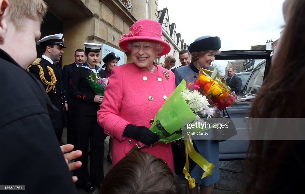 Queen <a gi-track='captionPersonalityLinkClicked' href=/galleries/search?phrase=Elizabeth+II&family=editorial&specificpeople=67226 ng-click='$event.stopPropagation()'>Elizabeth II</a> is given flowers as she leaves the recently refurbished Bristol Old Vic Theatre during her visit to Bristol as part of her Jubilee tour on November 22, 2012 in Bristol, England.