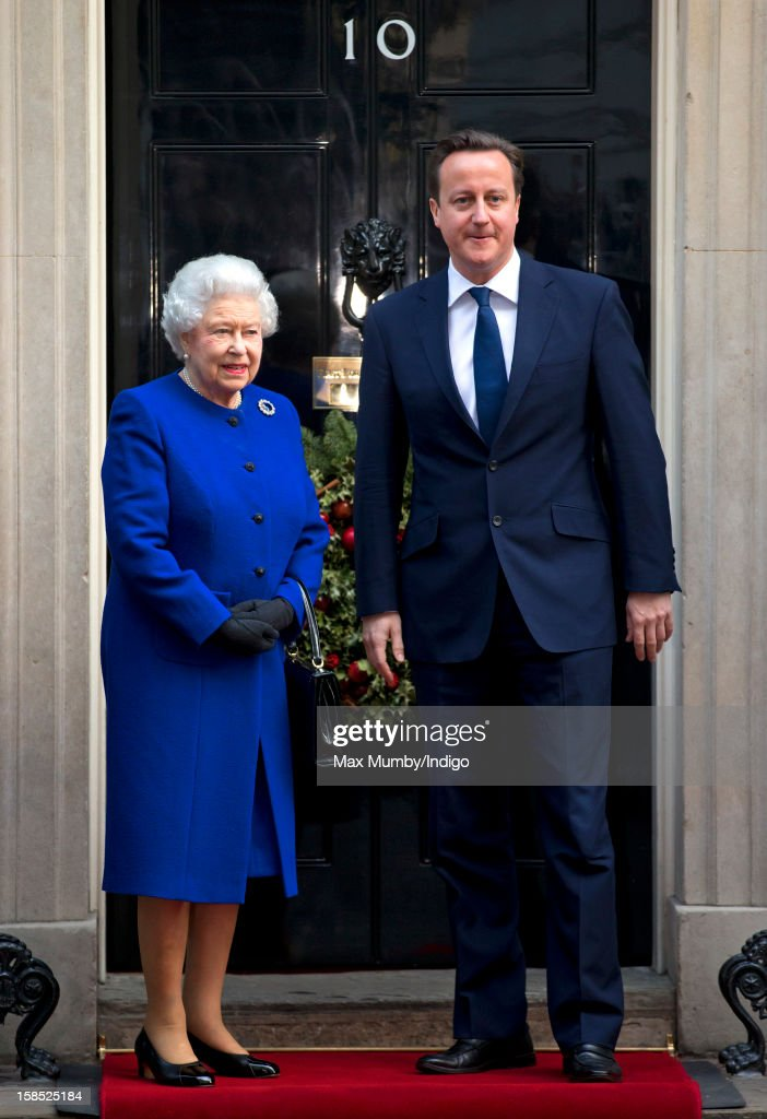 Queen <a gi-track='captionPersonalityLinkClicked' href=/galleries/search?phrase=Elizabeth+II&family=editorial&specificpeople=67226 ng-click='$event.stopPropagation()'>Elizabeth II</a> is greeted by British Prime Minister <a gi-track='captionPersonalityLinkClicked' href=/galleries/search?phrase=David+Cameron+-+Politician&family=editorial&specificpeople=227076 ng-click='$event.stopPropagation()'>David Cameron</a> on the doorstep of Number 10 Downing Street as she arrives to attend the Government's weekly Cabinet meeting on December 18, 2012 in London, England. The Queen's visit to the weekly Cabinet meeting as an observer is the first time a Monarch has attended the meeting since Queen Victoria's reign.