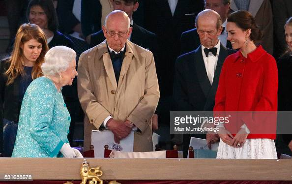 Queen Elizabeth II is greeted by Catherine Duchess of Cambridge as Prince Ludwig of Baden and Prince Edward Duke of Kent attend the final night of...