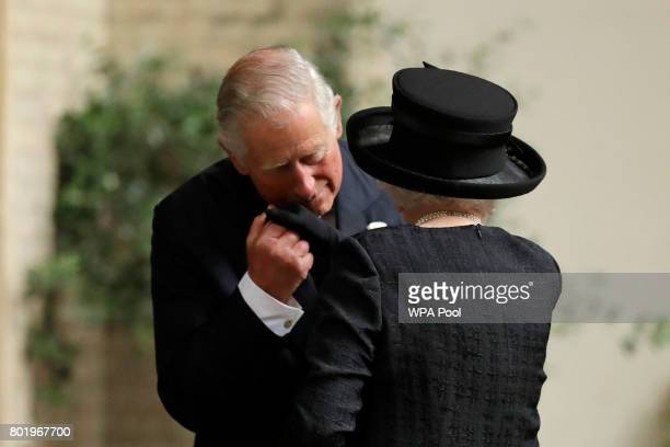 Queen Elizabeth II is greeted by her son Prince Charles Prince of Wales as she arrives at the funeral service of Patricia Knatchbull Countess...