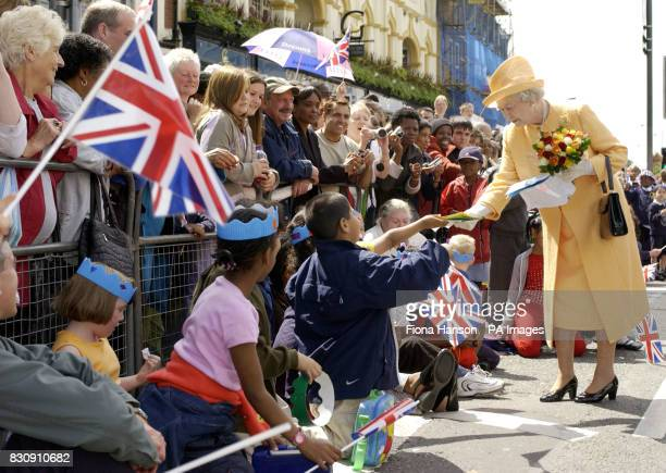 Queen Elizabeth II is greeted by large crowds in Catford southeast London during today's Golden Jubilee visit to south London