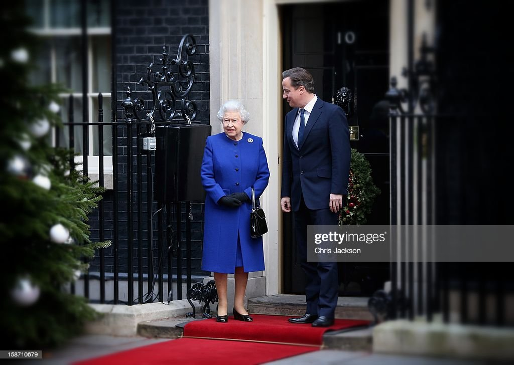 Queen Elizabeth II is greeted by Prime Minister <a gi-track='captionPersonalityLinkClicked' href=/galleries/search?phrase=David+Cameron+-+Pol%C3%ADtico&family=editorial&specificpeople=227076 ng-click='$event.stopPropagation()'>David Cameron</a> as she arrives at Number 10 Downing Street to attend the Government's weekly Cabinet meeting on December 18, 2012 in London, England.