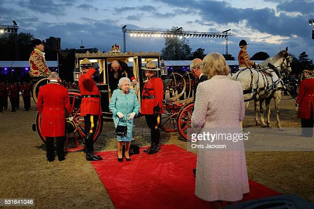 Queen Elizabeth II is greeted by Prince Charles Prince of Wales as she arrives for the final night of her 90th Birthday Celebrations at Windsor on...