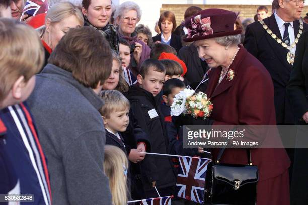 Queen Elizabeth II is greeted by pupils from the Special Educational Needs Unit and Learning Resource Centre at Smithdon High School in Hunstanton...