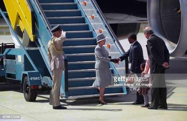 Queen Elizabeth II is greeted by South Africa's Deputy President Thabo Mbeki as she walks on South African soil for the first time since 1947 on her...