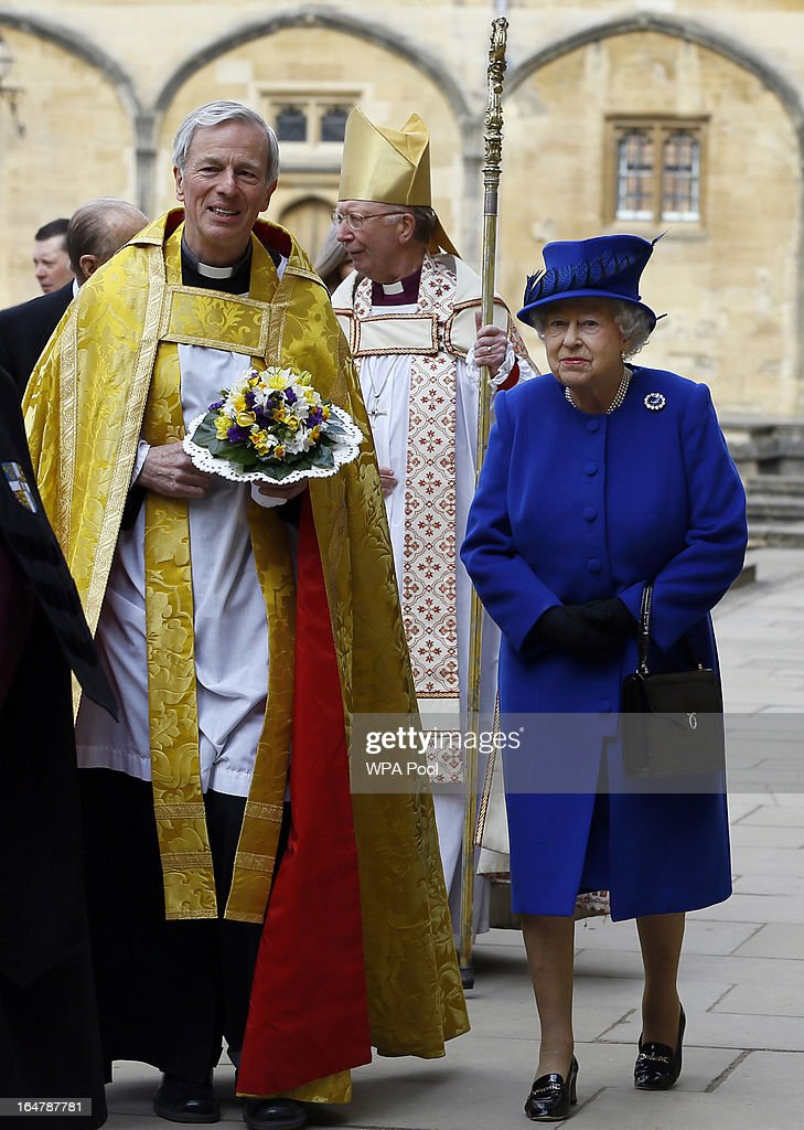 Queen <a gi-track='captionPersonalityLinkClicked' href=/galleries/search?phrase=Elizabeth+II&family=editorial&specificpeople=67226 ng-click='$event.stopPropagation()'>Elizabeth II</a> is greeted by The Dean Christopher Lewis as she arrives to attend the Maundy service, at Christ Church Cathedral on March 28, 2013 in Oxford, England. The Maundy money was today distributed by the Queen to 87 women and 87 men, who each received two purses, one red and one white. A 5 GBP coin and 50 pence coin commemorating the 60th anniversary of The Queen's Coronation in the red purse. The white purse contains the uniquely minted Maundy Money. This takes the form of silver one, two, three and four penny pieces, the sum of which equals the number of years the Monarch's age.