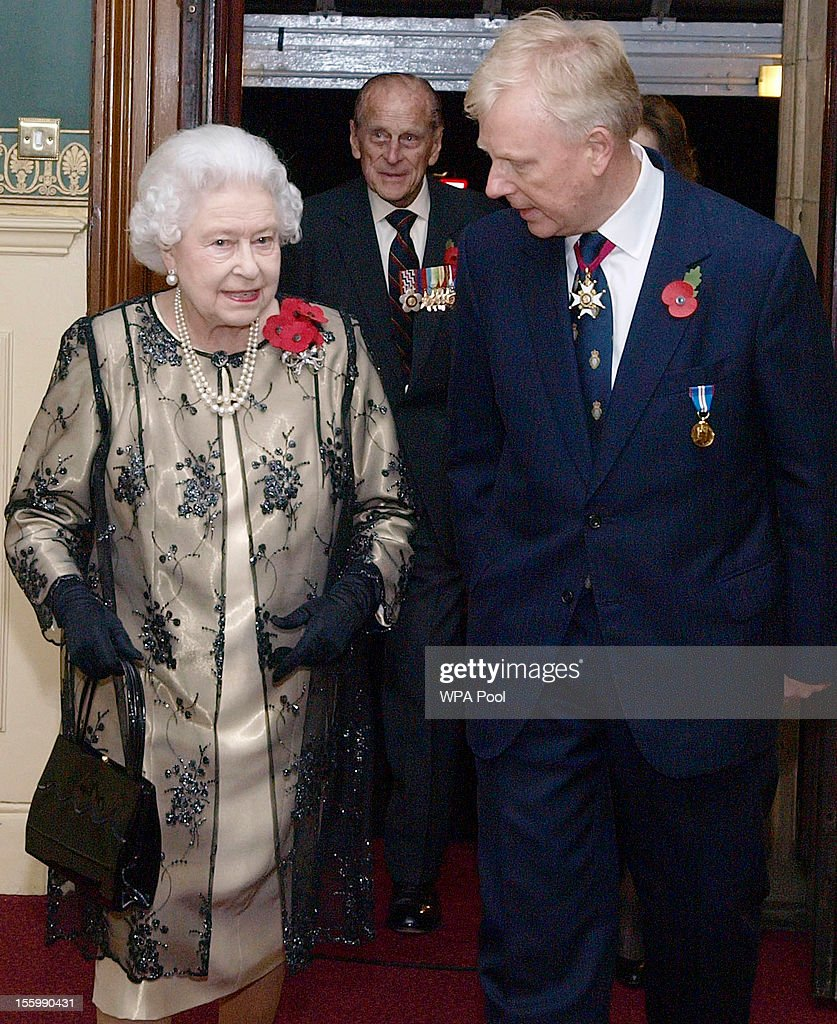 Queen <a gi-track='captionPersonalityLinkClicked' href=/galleries/search?phrase=Elizabeth+II&family=editorial&specificpeople=67226 ng-click='$event.stopPropagation()'>Elizabeth II</a> is greeted by the President of the Royal British Legion Vice- Admiral Peter Wilkinson, as she arrives to attend the annual Royal Festival of Remembrance, at London's Royal Albert Hall, on November 10, 2012 in London, England.