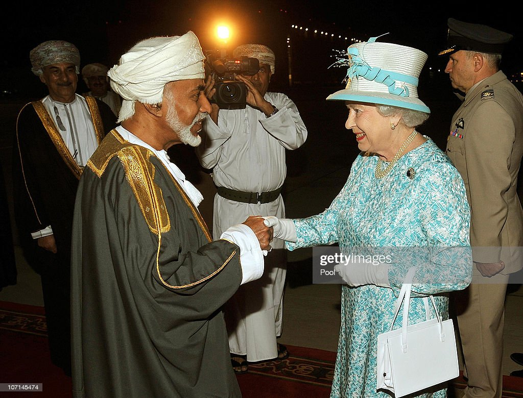 Queen Elizabeth II is greeted by the Sultan of Oman, His Majesty Qaboos bin Said Al Said, after arriving from the UAE on November 25, 2010 in Muscat, Oman. Queen Elizabeth II and Prince Philip, Duke of Edinburgh are in Oman on a State Visit to the Middle East. The Royal couple spent two days in Abu Dhabi and will stay three days in Oman.