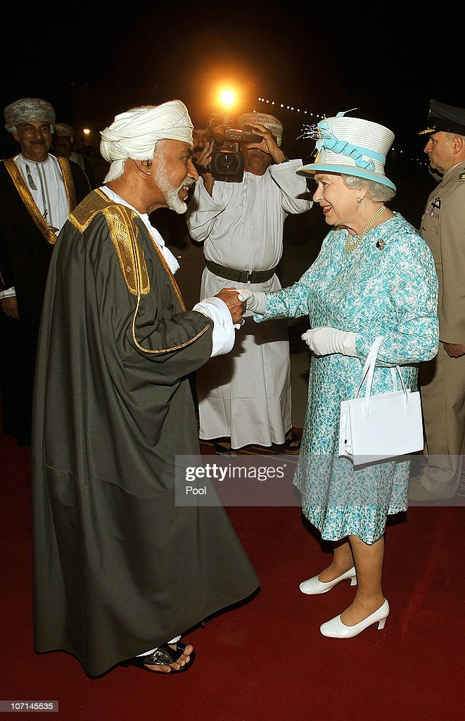 Queen <a gi-track='captionPersonalityLinkClicked' href=/galleries/search?phrase=Elizabeth+II&family=editorial&specificpeople=67226 ng-click='$event.stopPropagation()'>Elizabeth II</a> is greeted by the Sultan of Oman, His Majesty Qaboos bin Said Al Said, after arriving from the UAE on November 25, 2010 in Muscat, Oman. Queen <a gi-track='captionPersonalityLinkClicked' href=/galleries/search?phrase=Elizabeth+II&family=editorial&specificpeople=67226 ng-click='$event.stopPropagation()'>Elizabeth II</a> and Prince Philip, Duke of Edinburgh are in Oman on a State Visit to the Middle East. The Royal couple spent two days in Abu Dhabi and will stay three days in Oman.