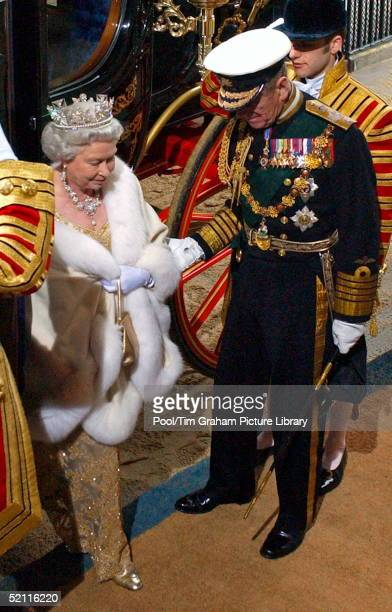 Queen Elizabeth II Is Helped Down From Her Carriage By Prince Philip As They Arrive At The Sovereign's Entrance Of The House Of Lords For The State...