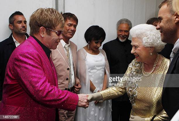 Queen Elizabeth II is introduced to Sir Elton John backstage by Gary Barlow after the Diamond Jubilee Buckingham Palace Concert June 04 2012 in...