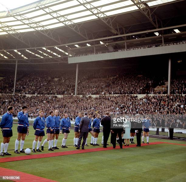 HRH Queen Elizabeth II is introduced to the England team by FIFA President Sir Stanley Rous before the opening match of the Finals The England...