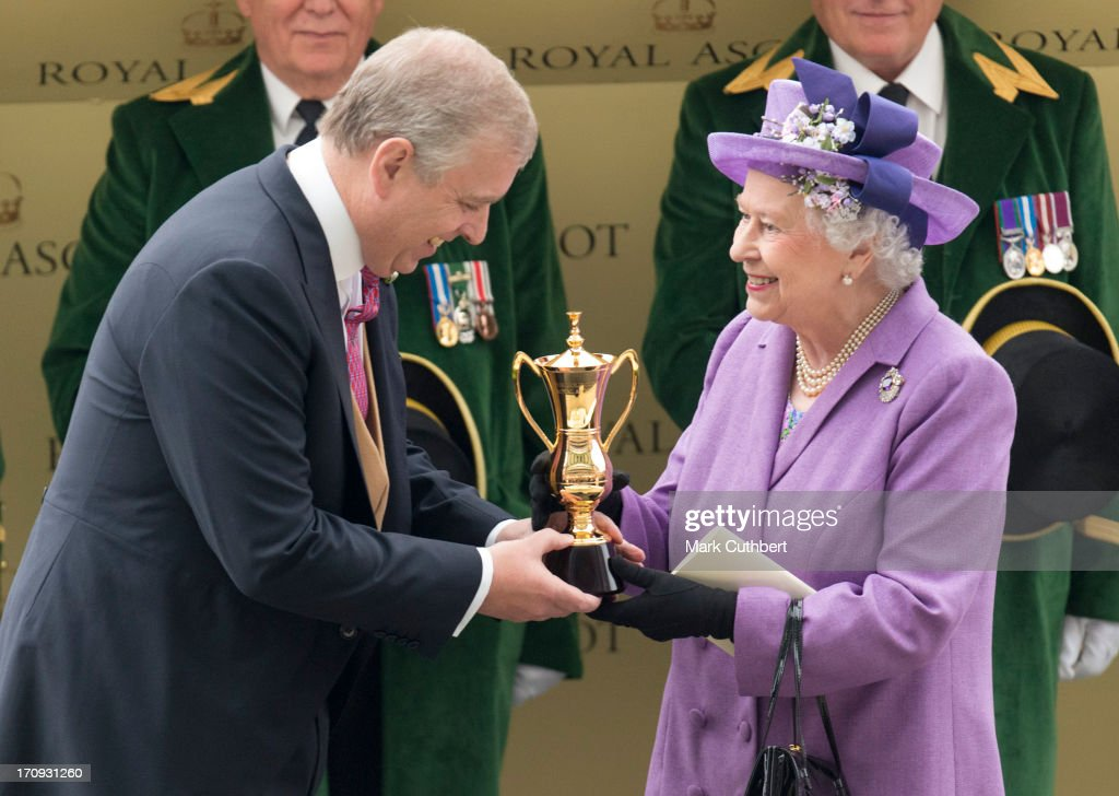 Queen <a gi-track='captionPersonalityLinkClicked' href=/galleries/search?phrase=Elizabeth+II&family=editorial&specificpeople=67226 ng-click='$event.stopPropagation()'>Elizabeth II</a> is presented The Gold Cup by <a gi-track='captionPersonalityLinkClicked' href=/galleries/search?phrase=Prince+Andrew+-+Duke+of+York&family=editorial&specificpeople=160175 ng-click='$event.stopPropagation()'>Prince Andrew</a>, Duke of York after her horse 'Estimate' won during Ladies Day on Day 3 of Royal Ascot at Ascot Racecourse on June 20, 2013 in Ascot, England.